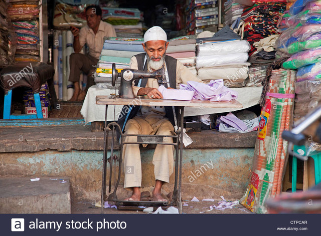 [Image: tailor-making-clothes-on-old-sewing-mach...CTPCAR.jpg]